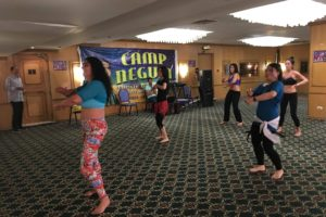 A group of people dancing at Camp Negum